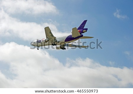 LOS ANGELES/CALIFORNIA - AUG. 5, 2016: Fed Ex (Federal Express) McDonnell Douglas MD-10 cargo aircraft approaches runway for a landing at Los Angeles International Airport, Los Angeles, California USA