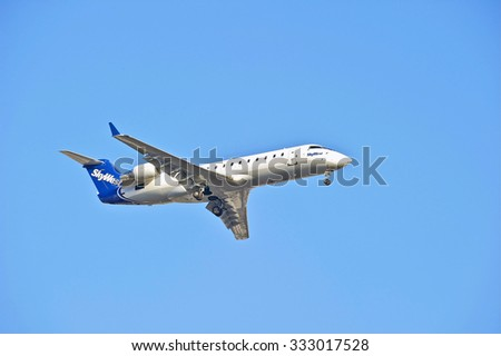 LOS ANGELES/CALIFORNIA - AUG. 6, 2015 SkyWest Airlines Canadair CL-600 commercial jet on approach to runway at Los Angeles International Airport in Los Angeles, California, USA