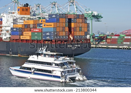 LOS ANGELES/CALIFORNIA - AUGUST 22, 2014: Korea's Hanjin Shipping container vessel arrives at the Port of Los Angeles, the largest port in USA August 22, 2014 in San Pedro, California USA  - stock photo