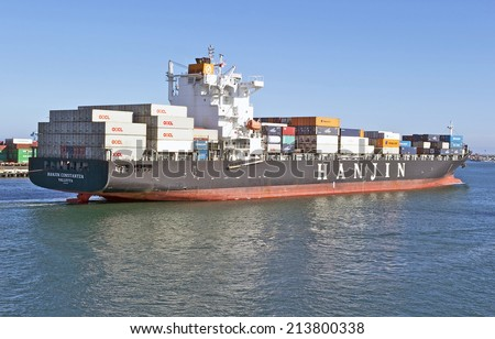 LOS ANGELES/CALIFORNIA - AUGUST 22, 2014: Korea's Hanjin Shipping container vessel departs the Port of Los Angeles, the largest port in USA August 22, 2014 in San Pedro, California USA  - stock photo