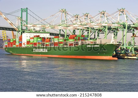 LOS ANGELES/CALIFORNIA - AUGUST 22, 2014: Taiwan's Evergreen Marine container vessel being loaded at the Port of Los Angeles, the largest port in USA August 22, 2014 in San Pedro, California USA  - stock photo