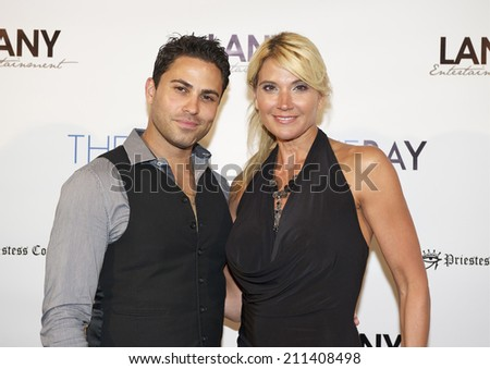 "LOS ANGELES/CALIFORNIA - AUGUST 4, 2014: Tina Gianni & Carlo Mendez walk the red carpet at ""The Bay"" Red Carpet Extravaganza hosted by LANY Entertainment August 4, 2014 Hollywood, California USA"