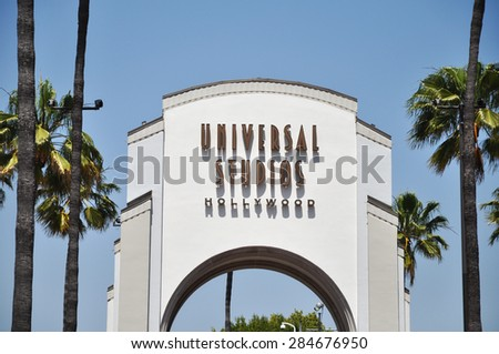 LOS ANGELES, CALIFORNIA - CIRCA MAY 2012: Entrance gate for the Universal Studios Hollywood , surrounded by palms - stock photo