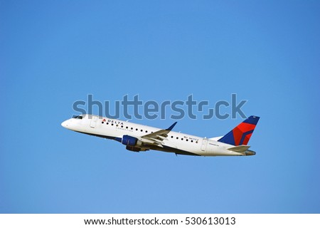 LOS ANGELES/CALIFORNIA - DEC. 3, 2016: Delta Air Lines Embraer ERJ-175LR aircraft is airborne as it departs Los Angeles International Airport, Los Angeles, California USA