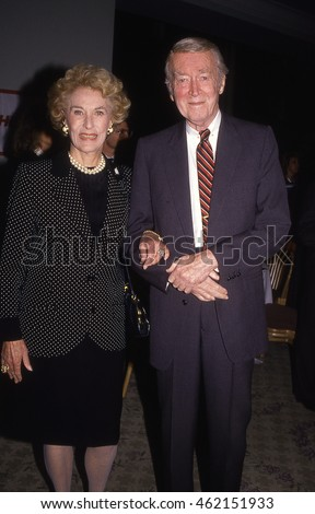 LOS ANGELES, CALIFORNIA - Exact date unknown -circa 1990 - Jimmy Stewart and wife Gloria Stewart posing at a formal celebrity event