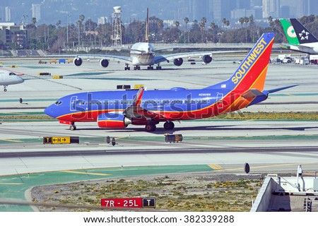 LOS ANGELES/CALIFORNIA - FEB. 21, 2016: Southwest Airlines Boeing 737-7H4 taxiing along the runway upon arrival to Los Angeles International Airport, Los Angeles, California USA - stock photo