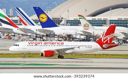 LOS ANGELES/CALIFORNIA - FEB. 21, 2016: Virgin America Airbus A320-214 taxiing along runway as it arrives at  Los Angeles International Airport, Los Angeles, California USA     - stock photo