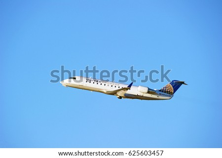 LOS ANGELES/CALIFORNIA - JANUARY 14, 2017: United (Express) Airlines Bombardier CRJ-200ER aircraft is airborne as it departs Los Angeles International Airport. Los Angeles, California USA