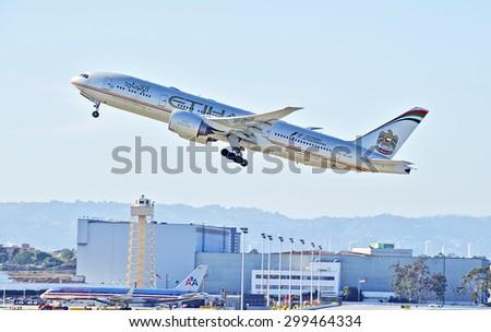 LOS ANGELES/CALIFORNIA - JULY 12, 2015: Etihad Airways Boeing 777 as it departs Los Angeles International Airport in Los Angeles, California, USA - stock photo