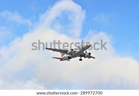 LOS ANGELES/CALIFORNIA - JUNE 13, 2015: American Airlines commercial jet on approach to runway at Los Angeles International Airport in Los Angeles, California, USA