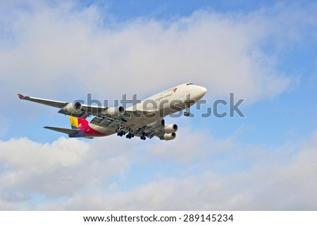 LOS ANGELES/CALIFORNIA - JUNE 13, 2015: Asiana Cargo Airlines commercial jet on approach to runway at Los Angeles International Airport in Los Angeles, California, USA