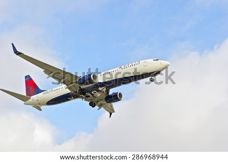 LOS ANGELES/CALIFORNIA - JUNE 13, 2015: Delta Airlines commercial jet on approach to runway at Los Angeles International Airport in Los Angeles, California, USA - stock photo
