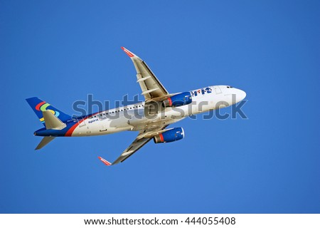 LOS ANGELES/CALIFORNIA - JUNE 18, 2016: Spirit Airlines Airbus A320 commercial aircraft is airborne as it departs Los Angeles International Airport, Los Angeles, California USA - stock photo