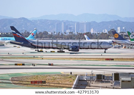 LOS ANGELES/CALIFORNIA - MAY 22, 2016: Aeroflot Russian Airlines Boeing 777 taxiing along runway just before departure from Los Angeles International Airport, Los Angeles, California USA - stock photo