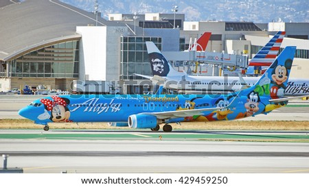 LOS ANGELES/CALIFORNIA - MAY 22, 2016: Alaska Airlines Boeing 737-990 commercial aircraft taxiing along runway upon arrival at Los Angeles International Airport, Los Angeles, California USA - stock photo