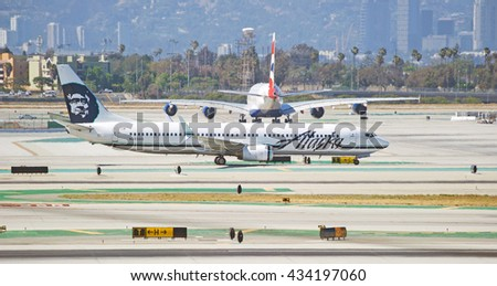 LOS ANGELES/CALIFORNIA - MAY 22, 2016: Alaska Airlines Boeing 737 commercial aircraft taxiing along runway before take off at Los Angeles International Airport, Los Angeles, California USA - stock photo
