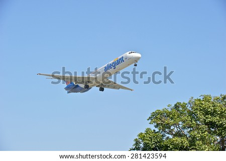 LOS ANGELES/CALIFORNIA - MAY 10, 2015: Allegiant Airlines commercial jet on approach to runway at Los Angeles International Airport in Los Angeles, California, USA - stock photo