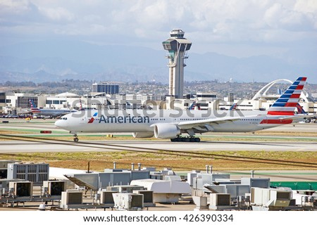 LOS ANGELES/CALIFORNIA - MAY 21, 2016: American Airlines Boeing 737 commercial aircraft taxiing along the tarmac at Los Angeles International Airport, Los Angeles, California USA - stock photo