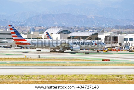 LOS ANGELES/CALIFORNIA - MAY 22, 2016: American Airlines Boeing 777 commercial aircraft taxiing along runway before take off at Los Angeles International Airport, Los Angeles, California USA   - stock photo