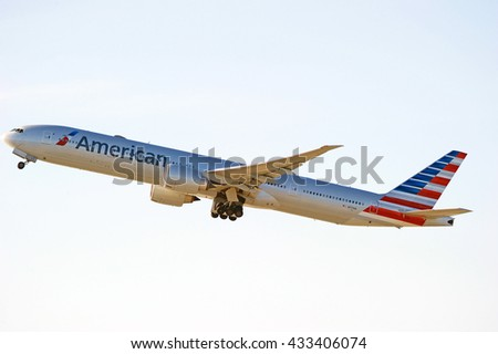 LOS ANGELES/CALIFORNIA - MAY 22, 2016: American Airlines Boeing 777-323(ER) commercial aircraft is airborne as it departs Los Angeles International Airport, Los Angeles, California USA - stock photo