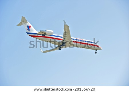LOS ANGELES/CALIFORNIA - MAY 10, 2015:  American Airlines commercial jet on approach to runway at Los Angeles International Airport in Los Angeles, California, USA