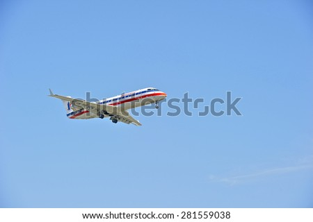 LOS ANGELES/CALIFORNIA - MAY 10, 2015:  American Airlines commercial jet on approach to runway at Los Angeles International Airport in Los Angeles, California, USA - stock photo