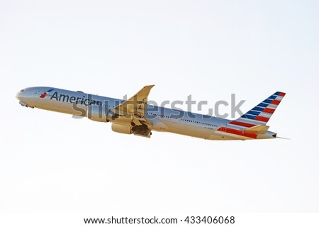 LOS ANGELES/CALIFORNIA - MAY 22, 2016: American Airlines 777-323(ER) commercial aircraft is airborne as it departs Los Angeles International Airport, Los Angeles, California USA - stock photo