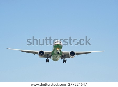 LOS ANGELES/CALIFORNIA - MAY 10, 2015: Commercial Cargo jet on approach to runway at Los Angeles International Airport in Los Angeles, California, USA