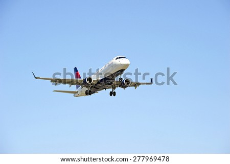 LOS ANGELES/CALIFORNIA - MAY 10, 2015: Delta Airlines commercial jet on approach to runway at Los Angeles International Airport in Los Angeles, California, USA