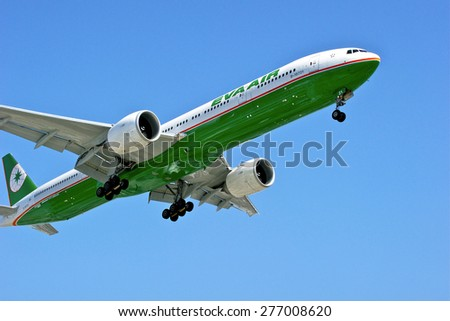 LOS ANGELES/CALIFORNIA - MAY 10, 2015: Eva Airways  commercial jet on approach to runway at Los Angels International Airport in Los Angeles, California, USA - stock photo