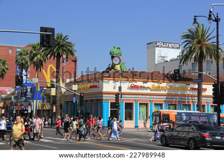 Los Angeles, California - May 19, 2014: Hollywood and Highland Intersection with Ripley's Believe It or Not at the corner and other stores in Los Angeles, California - stock photo