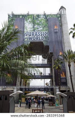 LOS ANGELES, CALIFORNIA - MAY 22, 2015: Mega poster promoting the new Steven Spielbergâ??s movie Jurassic World, in theaters June12, at the Hollywood and Highland mall. It should be a great blockbuster. - stock photo