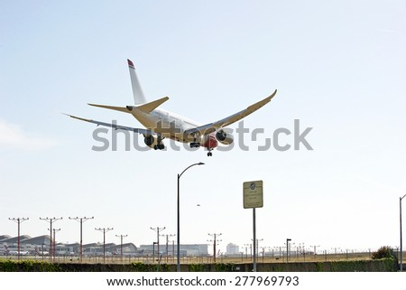 LOS ANGELES/CALIFORNIA - MAY 10, 2015: Norwegian Air commercial jet on approach to runway at Los Angeles International Airport in Los Angeles, California, USA