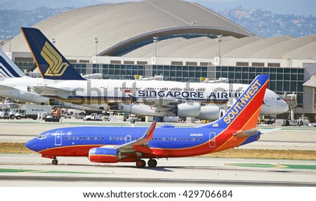 LOS ANGELES/CALIFORNIA - MAY 22, 2016: Southwest Airlines Boeing 737-7H4 commercial aircraft taxiing along runway upon arrival at Los Angeles International Airport, Los Angeles, California USA - stock photo