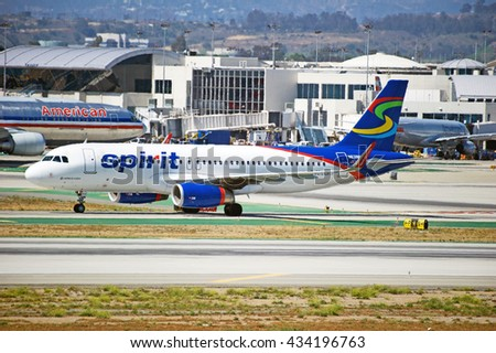 LOS ANGELES/CALIFORNIA - MAY 22, 2016: Spirit Airlines Airbus A320 commercial aircraft taxiing along runway upon arrival to Los Angeles International Airport, Los Angeles, California USA