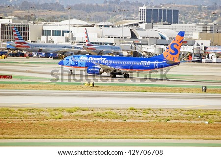 LOS ANGELES/CALIFORNIA - MAY 22, 2016: Sun Country Airlines Boeing 737 commercial aircraft taxiing along runway upon arrival at Los Angeles International Airport, Los Angeles, California USA - stock photo