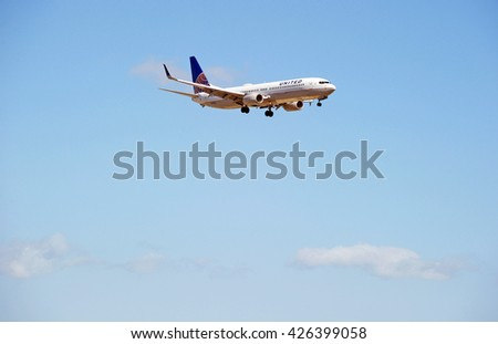 LOS ANGELES/CALIFORNIA - MAY 21, 2016: United Airlines Boeing 737-924(ER) commercial aircraft approaching the runway for a landing at Los Angeles International Airport, Los Angeles, California USA