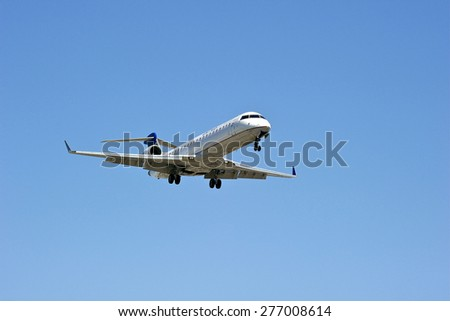 LOS ANGELES/CALIFORNIA - MAY 10, 2015: United Airlines commercial jet on approach to runway at Los Angels International Airport in Los Angeles, California, USA - stock photo