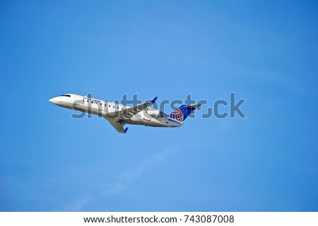 LOS ANGELES/CALIFORNIA - OCT. 21, 2017: United Airlines Bombardier CRJ-200ER aircraft is airborne as it departs Los Angeles International Airport. Los Angeles, California USA