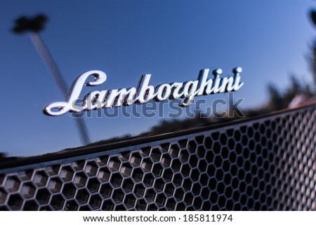 LOS ANGELES, CALIFORNIA - USA - ABRIL 6, 2014:  Lamborghini emblem  on exhibition parking at an annual event Supercar Sunday Lamborghini Day on Abril 6, 2014 in Los Angeles, USA. - stock photo