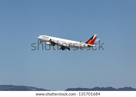 LOS ANGELES, CALIFORNIA, USA - APRIL 17 : Philippine Airlines Airbus A340-313X takes off from Los Angeles Airport on April 17, 2013. The plane has a range of 13,700 km and seats 335 passengers. - stock photo