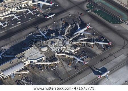 Los Angeles, California, USA - August 16, 2016:  Afternoon aerial view of jet airplanes and terminals at LAX.