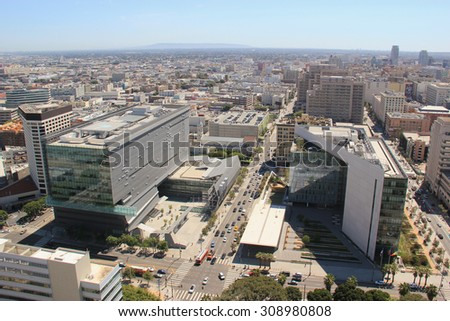 Los Angeles, California, USA - August 14, 2015: Downtown Los Angeles is composed of different areas from a fashion district to a skid row, and it is the hub of the city's Metro rapid transit system.  - stock photo