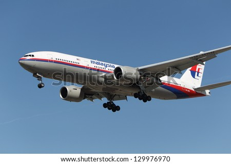 LOS ANGELES, CALIFORNIA, USA - February 22:Malaysia Airlines Boeing 777 lands at Los Angeles Airport on February 22, 2013. The plane has the most powerful jet engines in commercial service - stock photo