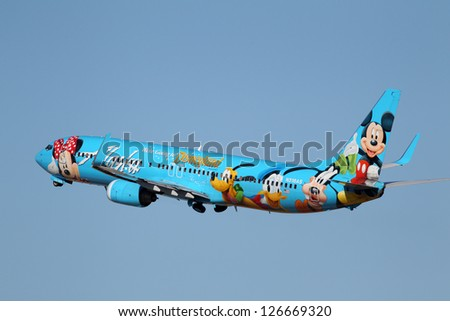 LOS ANGELES, CALIFORNIA, USA - JANUARY 28: An Alaska Airlines Spirit of Disneyland 737-400 takes off from Los Angeles Airport on January 28, 2013. It has a range of 2,370 miles and 144 seats. - stock photo