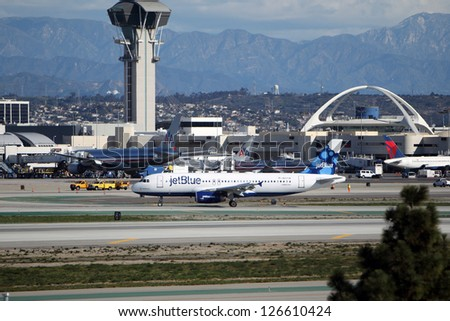 LOS ANGELES, CALIFORNIA, USA - JANUARY 28, 2013 - Jetblue Airbus A320-214 taxis at Los Angeles Airport on January 28, 2013. The plane has a range of range 3,300 miles with 150 passengers. - stock photo