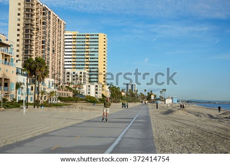 Los Angeles, California, USA - January 2013: Man runner on the track at the beach.