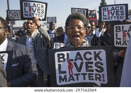 "Los Angeles, California, USA, January 19, 2015, 30th annual Martin Luther King Jr. Kingdom Day Parade, women hold sign ""Black Lives Matter"" - stock photo"