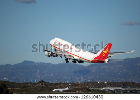 LOS ANGELES, CALIFORNIA, USA - JANUARY 28, 2013 - Yangtze River Express Boeing 747 takes-off from Los Angeles Airport on January 28, 2013. It is a converted  freighter by Israel Aerospace Industries. - stock photo