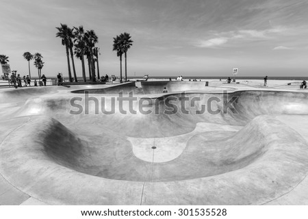 LOS ANGELES, CALIFORNIA, USA - June 20, 2014:  Deep concrete bowl at the popular Venice Beach skateboard park in Los Angeles, California. - stock photo